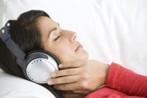 Woman Relaxing Listening To Music Wearing Headphones